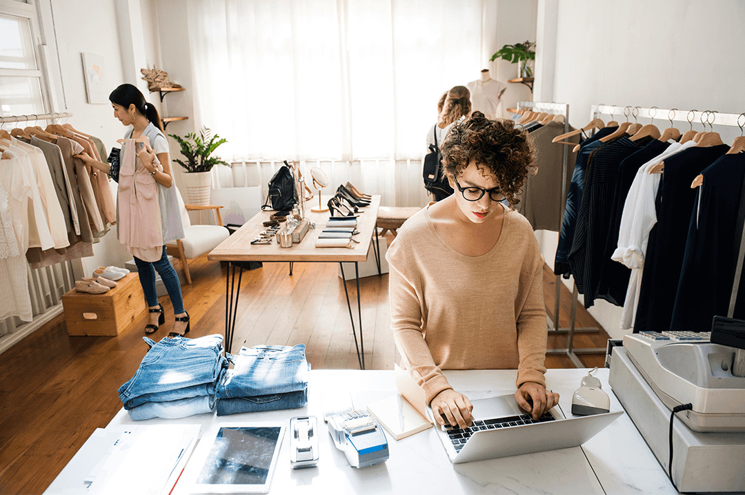female business owner is using laptop 1080x717 1